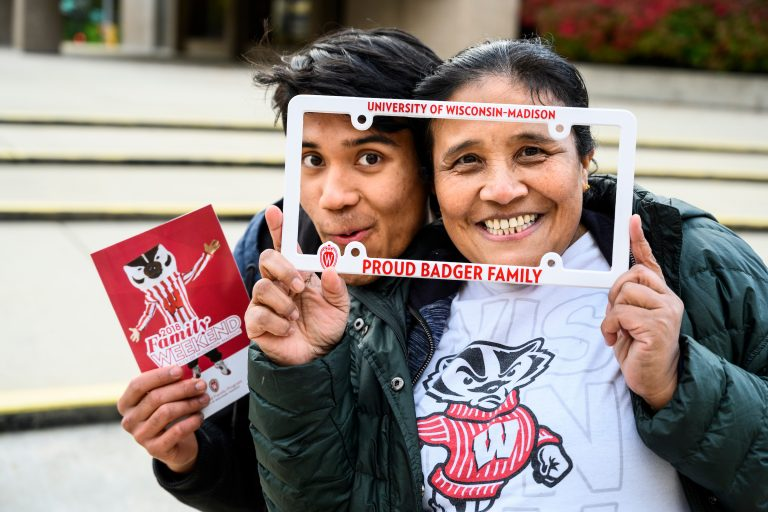 UW student and mother pose with Badger gear